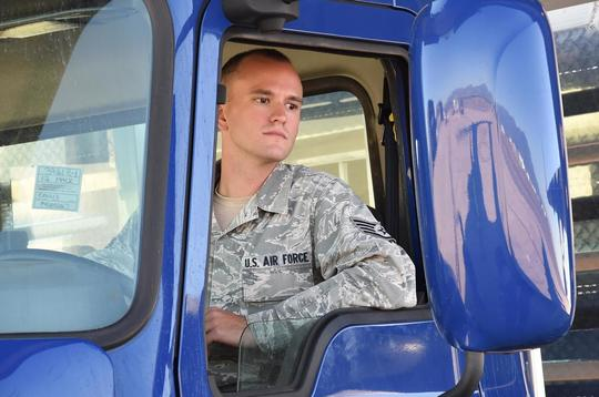 Air Force member driving a truck